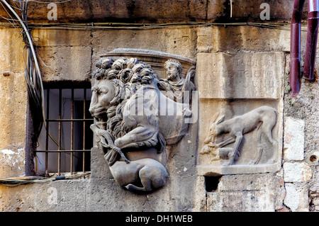 Roman high relief on the wall of Casa dei Manili, Rome Italy - Stock Photo