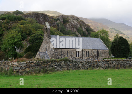 St Mary's Church Beddgelert with misty Snowdonia in the background Gwynedd Wales Cymru UK GB