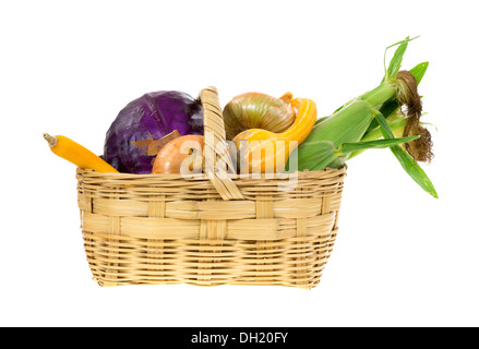 Corn, gourds, onions and red cabbage in an old wicker basket on a white background. - Stock Photo