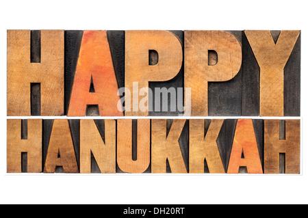 Happy Hanukkah - isolated words in vintage letterpress wood type - Stock Photo
