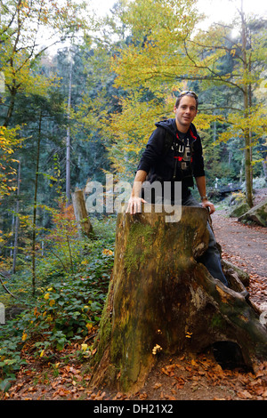 Man standing in a hollow tree trunk, Black Forest - Stock Photo