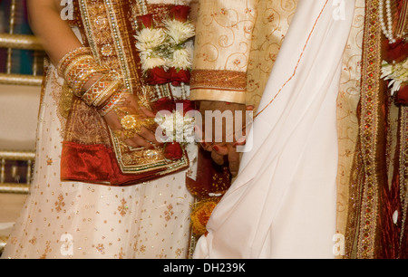 Bride and Groom dressed in all their finery celebrating their Traditional Hindu wedding.