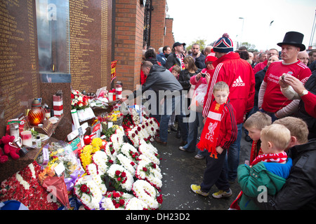 Beside the Shankly Gates at Anfield stands the memorial stone to the Liverpool supporters killed at Hillsborough - Stock Photo