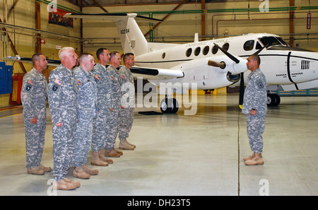 Soldiers assigned to the New York Army National Guard's Detachment 20, Operation Support Airlift Agency stand in - Stock Photo