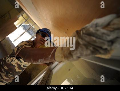 DILI, Timor-Leste – (Oct. 25, 2013) Timor-Leste Defense Force (F-FDTL) Engineer Soldier Leandro Carvalho waterproofs - Stock Photo