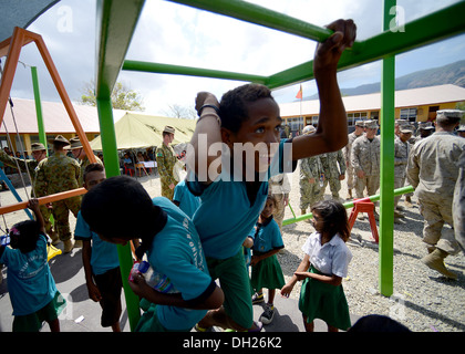METRINARO, Timor-Leste – (Oct. 28, 2013) A local Timorese child is the first to conquer the monkey bars at his school's - Stock Photo