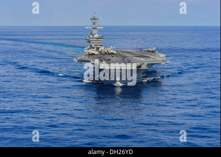 aircraft carrier USS Theodore Roosevelt (CVN 71) transits the Atlantic Ocean. Theodore Roosevelt is underway conducting - Stock Photo
