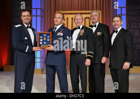 New York Air National Guard Staff Sgt. Christopher Petersen ( second from left) receives a plaque recognizing him - Stock Photo