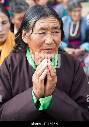 Tibetan woman in traditional dress amid the crowds as H. H. the Dalai Lama conducts teachings at 2013 Kalachakra - Stock Photo