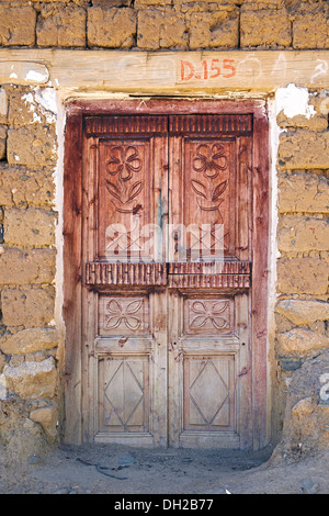 Old Wooden Door In Old Adobe House With Tile Roof Stock