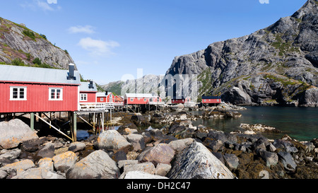 Red fishermen's houses, called rorbuer, A, Nusfjord, Lofoten, Nordland, Norway - Stock Photo