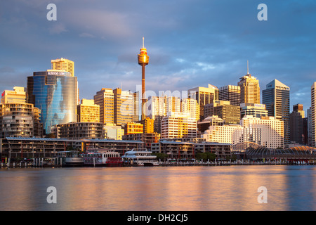The view towards Sydney CBD and King St Wharf from Darling Harbour on a warm spring evening - Stock Photo