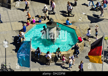 View of the fountain on Marienplatz square in the city centre, the central point of the pedestrian zone, Munich, - Stock Photo