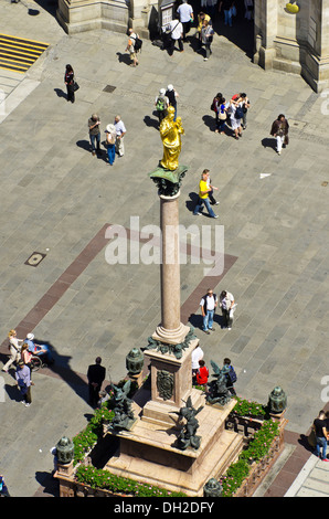 View of Mariensaeule column on Marienplatz square in the city centre, the central point of the pedestrian zone, - Stock Photo
