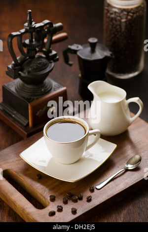 Coffee with milk in a traditional vintage setting - Stock Photo