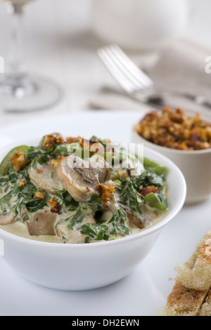 Mushrooms with spinach and green vegetables, served with nut crumble, and flatbread - Stock Photo