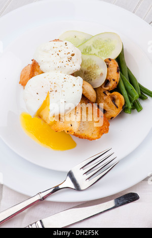 poached egg with salad, mushroom and bread - Stock Photo