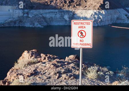 Restricted Area No Trespassing warning sign - Lake Mead, Las Vegas, Nevada USA - Stock Photo