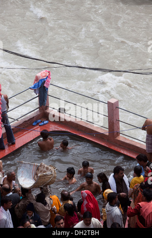people bathing in hot water spring next to Alaknanda river badrinath Uttarakhand India Asia - Stock Photo