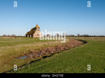 The Church of St. Thomas a Becket, set on marshland at Fairfield in Kent; on a clear sunny day. - Stock Photo