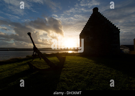 Islands of Orkney, Scotland. Dusk view of the late 17th century Store House at Holm on the east of Orkney's island - Stock Photo