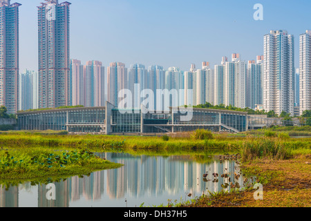 Hong Kong residential high rise cityscape viewed from Wetland Park. - Stock Photo