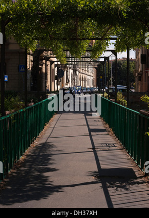 A covered bridge over a tributary to the river Arno in Florence, Italy - Stock Photo
