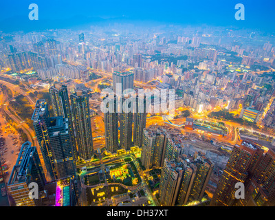Hong Kong cityscape with hazy skies in the Kowloon district. - Stock Photo