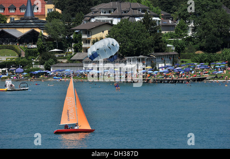A view of the Lake of the popular holiday resort of Velden am Worthersee in Austria - Stock Photo