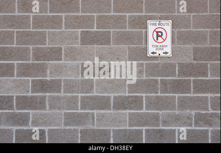 Fire Route sign on cement block wall - Stock Photo