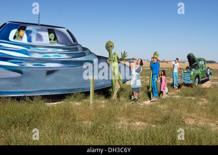 Roadside display depicting a UFO, aliens and local people welcoming them outside of Roswell, New Mexico. - Stock Photo