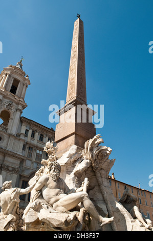 Fountain of the four Rivers with Egyptian obelisk in Piazza Navona, Rome, Italy - Stock Photo