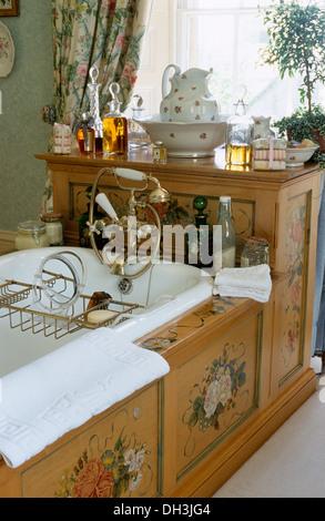 Roll Top Bath With Wooden Bath Rack In Pale Green Bathroom