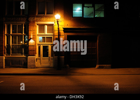 Atmospherically lit front in the historic old town of Montreal, Quebec, Canada - Stock Photo