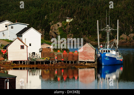 Houses and fishing boats on the Atlantic Ocean, New World Island in Twillingate, Newfoundland, Canada, North America - Stock Photo