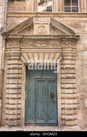 Carved stone doorway in old section of historic town of Pezenas; Herault; France - Stock Photo