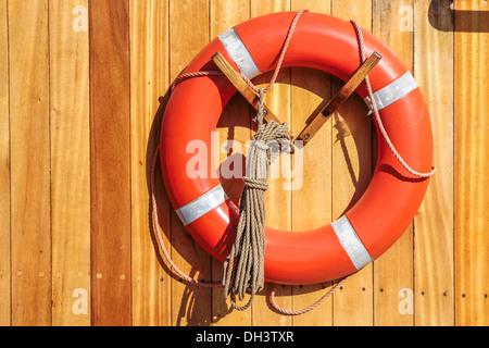 Orange lifebuoy on old sailing ship in Amaliehaven, Copenhagen, Denmark - Stock Photo