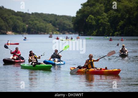 Kayakers paddling on a lake in Bella Vista, Arkansas, USA. - Stock Photo
