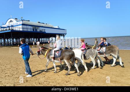 Children's donkey rides on Cleethorpes Beach, Cleethorpes, Lincolnshire, England, United Kingdom - Stock Photo