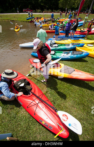 People attending a public kayaking event on a lake in Bella Vista, Arkansas, USA. - Stock Photo
