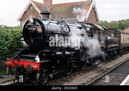 Ivatt (Mucky Duck) class 4MT number 43106 Steam Locomotive standing at Bishops Lydeard station on the West Somerset - Stock Photo