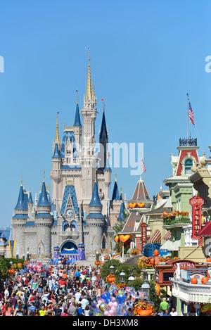 Disney World Resort View of Cinderella Castle in Autumn, October with Halloween Decorations, Magic Kingdom, Orlando - Stock Photo