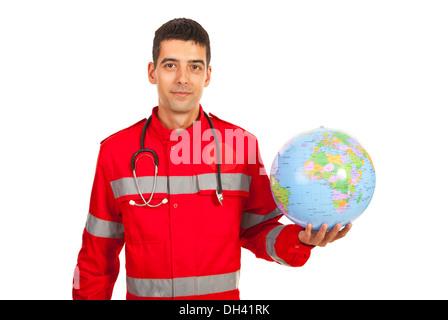 Paramedic man holding world globe isolated on white background - Stock Photo