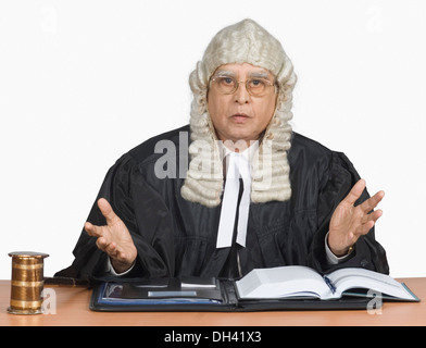 Portrait of a male judge giving judgment - Stock Photo