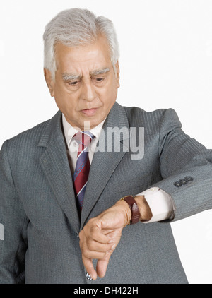 Close-up of a businessman checking the time - Stock Photo