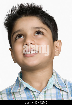 Close-up of a boy day dreaming - Stock Photo