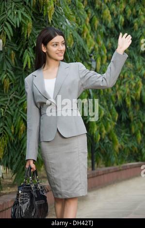 Businesswoman waving her hand - Stock Photo