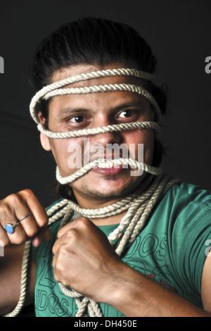 man tied with rope on face   MR#786 - Stock Photo