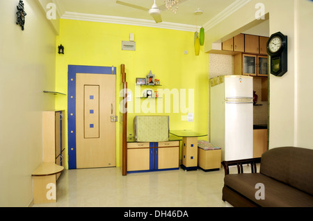 Living Room interior sofa fridge table door clock in Mumbai Maharashtra India - PR#364 - RMM 184956 - Stock Photo