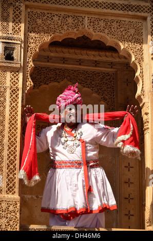 indian man in Rajasthani dress costume holding dupatta Jaisalmer Rajasthan India Asia   MR#784B - Stock Photo